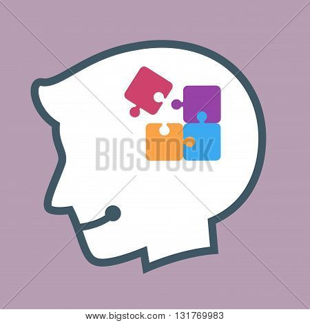 Vector stock of human head silhouette with puzzle pieces inside