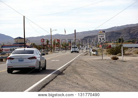 LAS VEGAS, USA - DECEMBER 22: Traffic with cars on the main road with gas stations shops and restaurants on December 22, 2015 in Barstow.