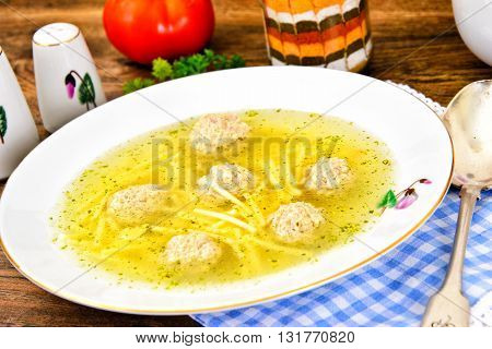 Chicken Soup with Meatballs on Plate. Studio Photo