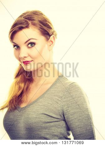 Fashion makeup beauty fashion concept. Smiling girl cheering for picture. Young lady in gray sweater