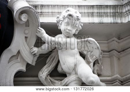VIENNA, AUSTRIA - OCTOBER 10: Angel, detail from the house of the Knights of the Cross with the Red Star on October 10, 2014 in Vienna. The Knights ware a religious order from Bohemia