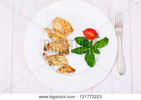 Grilled Chicken Fillet with Pepper,  Basil and Tomato Studio Photo