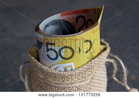 Australian currency notes in a hessian bag.