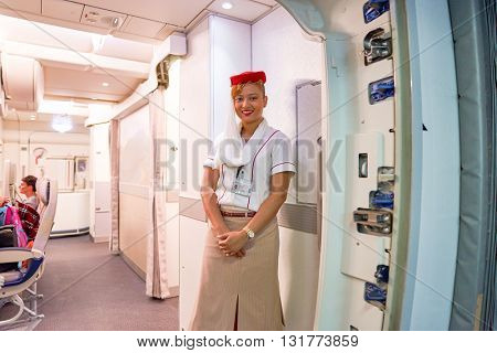 DUBAI, UAE - CIRCA APRIL, 2016: Emirates crew member meet passengers on board of Boeing 777. Emirates is one of two flag carriers of the UAE along with Etihad Airways and is based in Dubai.