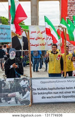 Berlin Germany - May 14 2016: demonstration with unidentified people in front of Brandenburger Gate. It is a demonstration against executions in Iran