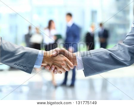 Business handshake and business people shaking hands