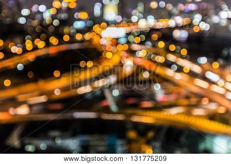 Abstract blurred bokeh lights, highway intersection close up