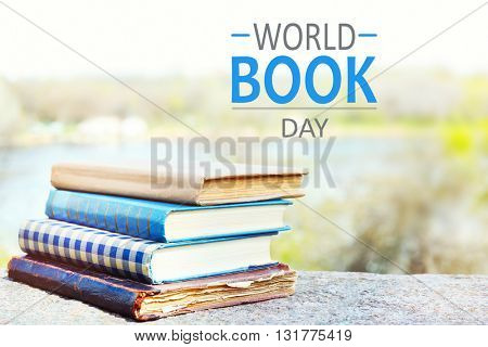 Stacked books on bright background. World Book Day poster
