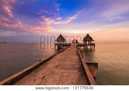 Abandon temple in the sea, with beautiful sky background during sunset