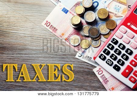 Banknotes and coins on wooden table.Taxes concept