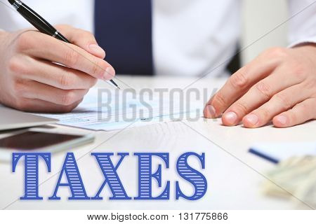 Man filling income tax form.Taxes concept
