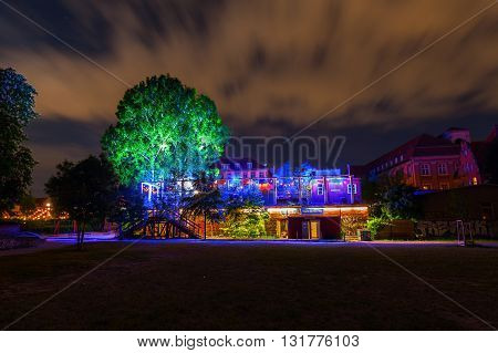 Berlin Germany - May 16 2016: night view of the Maerchenhuette in Monbijoupark in Berlin. It is is a theatre for fairy tales of Brothers Grimm opening in winter season