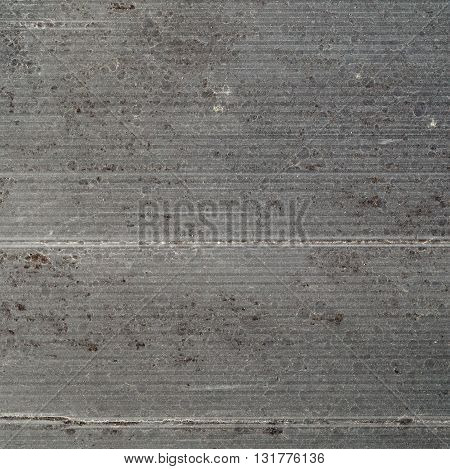 old dirty gray stained rough corrugated cardboard
