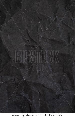 Crumpled black sandpaper texture. crumpled paper. crumpled texture