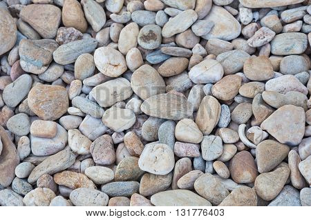 Dry round stones, abstract natural landscape background