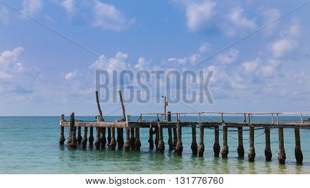 A wooden plank walkway leading to the sea, natural sky line background landscape