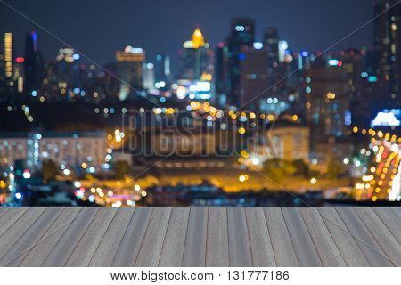 Opening wooden floor, Abstract blurred bokeh lights, central business downtown background