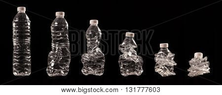 different steps of compressing a plastic bottle isolated on black background