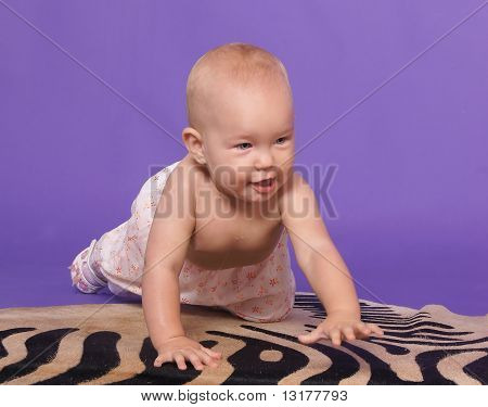 Little Baby Girl On Artificial Zebra Skin At The Studio On The Floor