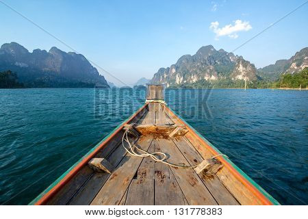 Old wooden Boat heading to island in Thailand.