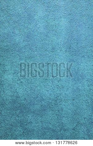 ROUGH WEATHERED WALL, BRIGHT BLUE PAINT, CLOSEUP BACKGROUND