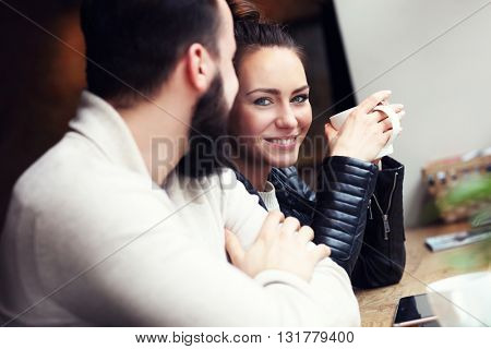 Young people in cafe looking at each other