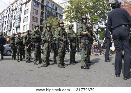 SAN DIEGO USA - MAY 27 2016: Riot police prepare to march and use crowd dispersion tactics on protesters outside a Trump rally at San Diego Convention Center.