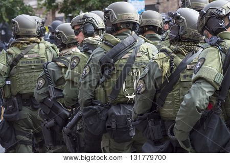 SAN DIEGO USA - MAY 27 2016: Riot police stand in formation ready to confront protesters at an anti-Trump rally at the San Diego Convention Center