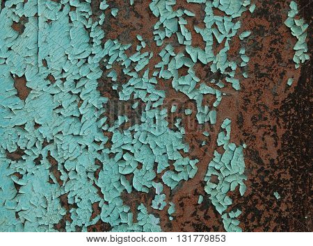 Old light blue paint on rusty metal