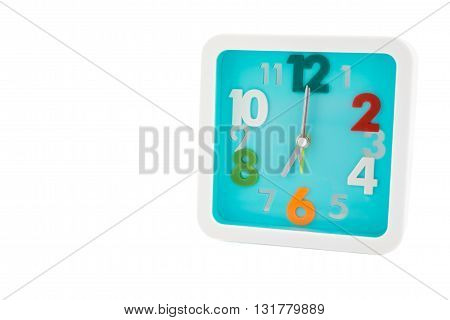Isolated light blue square alarm clock with colorful numbers - isolated clock on white background