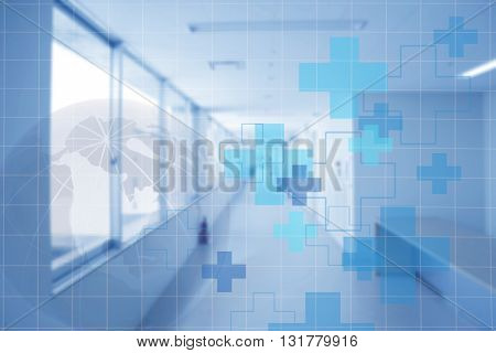 Hospital walkway in building with global in blue background.