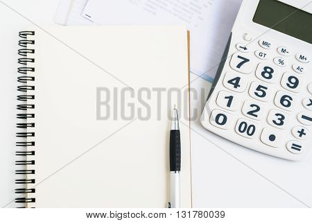 Concept of expenses and personal payment open notebook with pen calculator and bills