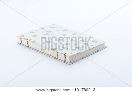 Closeup of handmade book on white background