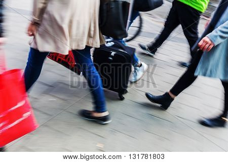 commuters walking in the city in motion blur