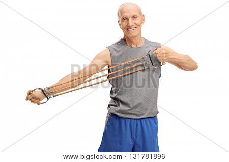 Active senior exercising with a resistance band isolated on white background