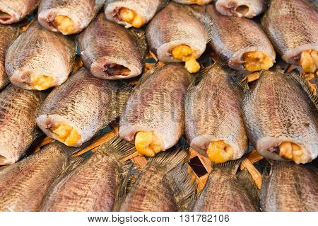 close up of dry gourami fish in tray