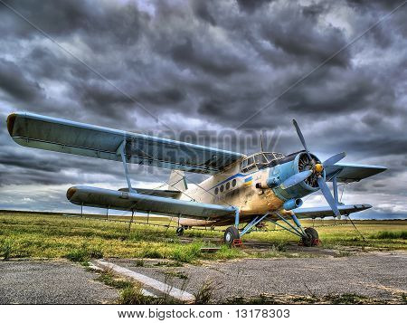 Old Plane On Airfield At Stormy Weather