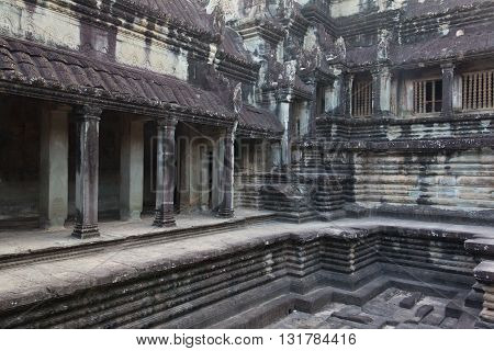 Ancient Angkor Wat temple pool and hallway