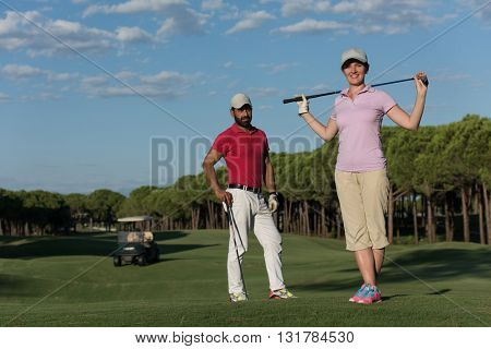 portrait of happy young  couple on golf course