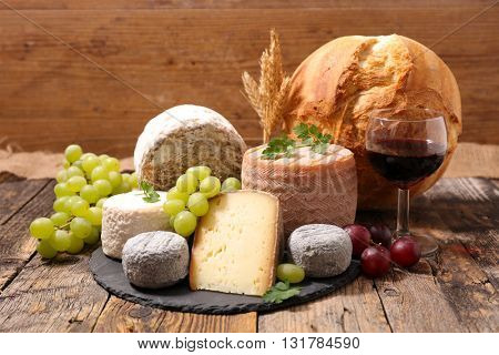 assorted cheese and wine glass
