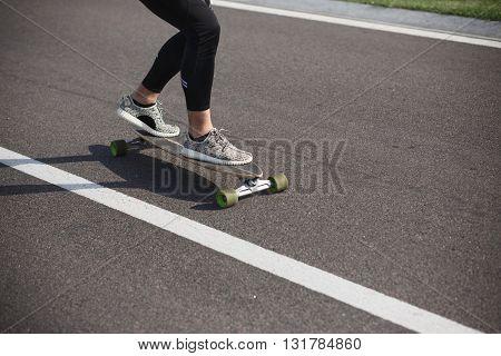 Sportive cool on skateboard or longboard - cool street skateboarder in a urban setting - fashion, sport, lifestyle concepts.