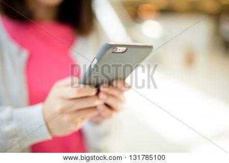 Woman sending sms on phone