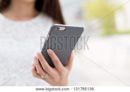 Woman browsing internet on smart phone