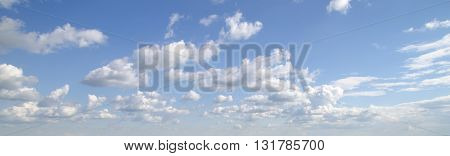 White fluffy clouds fly in sky. White cloud with many other clouds
