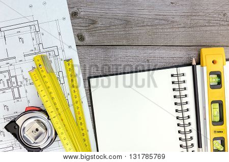 Architect Workspace With Blueprint, Tools, Notepad And Pencil