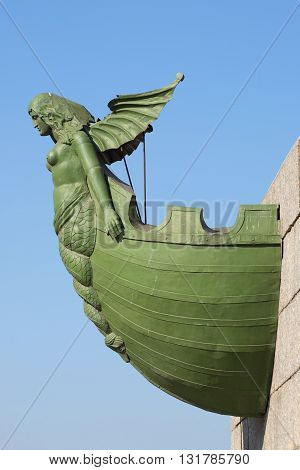 SAINT PETERSBURG, RUSSIA - MARCH 28, 2016: Rostra of the ship with Naiad at the base of the North the Rostral columns. Historical landmark of the city Saint Petersburg