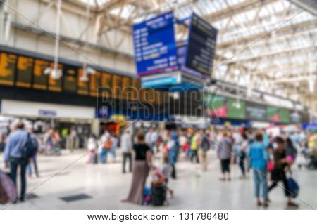 Blurry Crowded Bokeh Background Of Train Station.