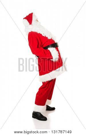 Full length Santa Claus grabbing his belly
