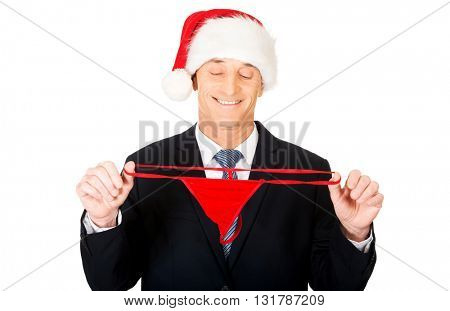 Portrait of santa businessman with female thongs