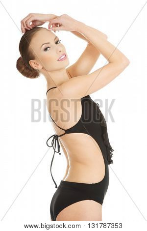 Happy young woman in swimsuit.